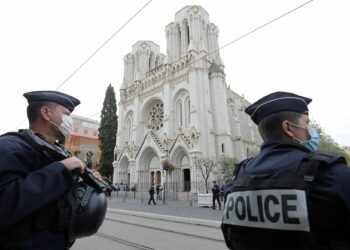 Police officers stand guard at the scene of a reported knife attack at Notre Dame church in Nice, France, October 29, 2020. REUTERS/Eric Gaillard/Pool     TPX IMAGES OF THE DAY