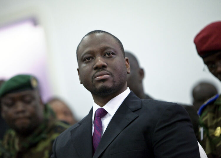 Prime Minister Guillaume Soro is seen during the swearing-in ceremony of opposition leader Alassane Ouattara at the Gulf hotel in Abidjan, Ivory Coast, Saturday, Dec. 4, 2010. The two candidates in Ivory Coast's disputed presidential election took dueling oaths of office Saturday after each claimed victory, as the political crisis spiraled out of control and renewed unrest in this country once split in two by civil war. (AP Photo/Thibault Camus)