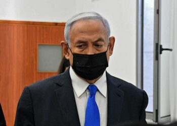 Israeli Prime Minister Benjamin Netanyahu arrives to a hearing in his corruption trial at the Jerusalem district court, on February 8, 2021. - Israel's Prime Minister Benjamin Netanyahu returns to court to formally respond to the corruption charges against him, as his trial enters an intensified phase six weeks before he faces re-election. (Photo by - / POOL / AFP)