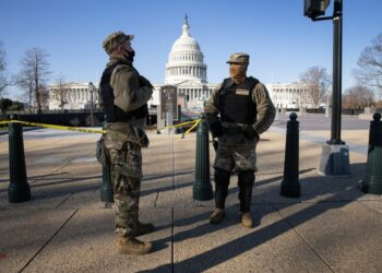WASHINGTON, DC - JANUARY 07: DC National Guard guardsmen stand outside the U.S. Capitol on January 07, 2021 in Washington, DC. Supporters of President Trump had stormed and desecrated the building the day before as Congress debated the a 2020 presidential election Electoral Vote Certification.   John Moore/Getty Images/AFP