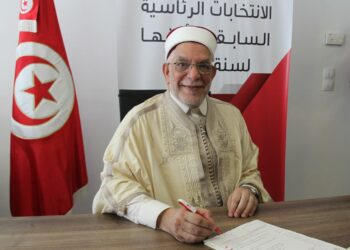 (FILES) In this file photo taken on August 09, 2019, Abdelfattah Mourou, Tunisia's interim parliamentary speaker and Islamist-inspired Ennahda Party politician, submits his candidacy for the upcoming early presidential elections at the Independent High Authority for Elections (ISIE) in the capital Tunis - Chastened by its early experiences of holding power in post-revolution Tunisia, Islamist-inspired party Ennahdha has moderated its image and selected lawyer Abdelfattah Mourou as its candidate for next Sunday's presidential election. (Photo by HASNA / AFP)